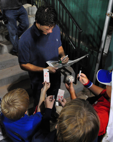 After the visiting Altoona Curve defeated The Portland Sea Dogs, 1-0, at Hadlock Field, on August 18th, 2010, winning pitcher Jeff Locke, signs autographs for fans.