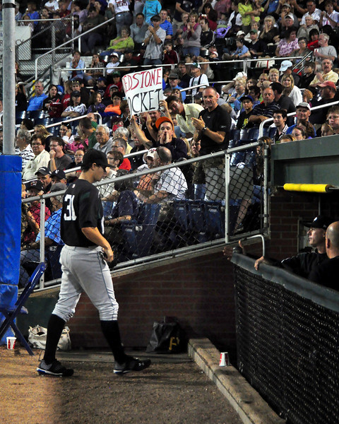 "Jeff Locke walks to the visiting Altoona Curve dugout, as a fan holds a sign ""Redstone Rocket"", referring to his hometown in New Hampshire. The Curve defeated The Portland Sea Dogs, 1-0, at Hadlock Field, on August 18th, 2010."