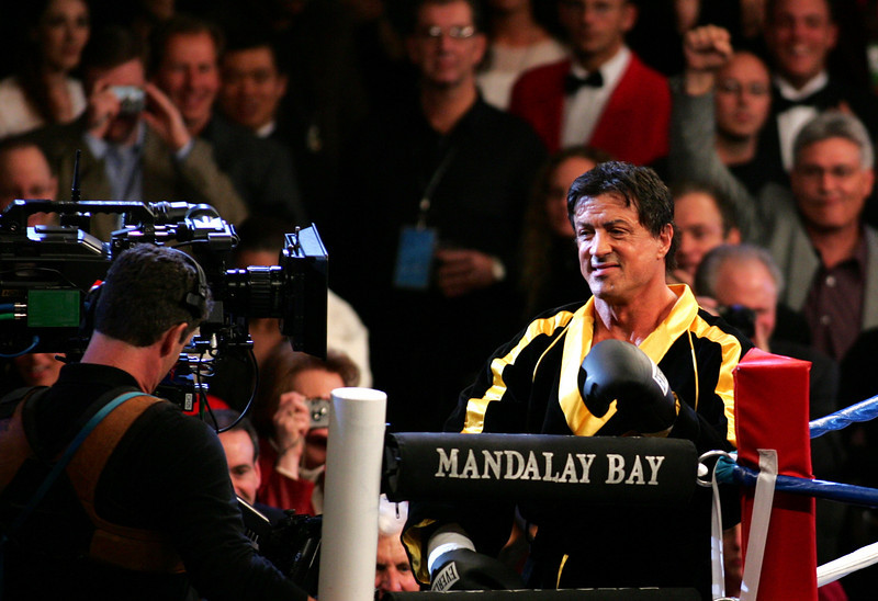 "Actor/Director Sylvester Stallone surprised a packed Mandalay Bay Event Center in Las Vegas on December 3, 2005 when he entered the arena with cast and crew in tow filming for his upcoming film ""Rocky VI"".  The sell-out crowd was on hand to watch the World Middleweight Championship boxing match between Jermain Taylor and Bernard Hopkins."