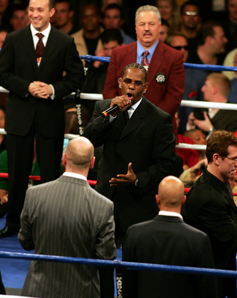 Singer R. Kelly performs the National Anthem with mixed reactions before a sell-out crowd at the Mandalay Bay Resort Event Center on December 3, 2005.  All were in attendance for the highly anticipated World Middleweight Championship boxing match between Jermain Taylor and Bernard Hopkins.  Taylor would later go on to successfully defend his title with a unanimous decision from the judges.
