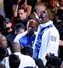 "Actor/Director Sylvester Stallone surprised a packed Mandalay Bay Event Center in Las Vegas on December 3, 2005 when he entered the arena with cast and crew in tow filming for his upcoming film ""Rocky VI"".  The sell-out crowd was on hand to watch the World Middleweight Championship boxing match between Jermain Taylor and Bernard Hopkins.  Antonio Tarver (shown on the far right in white & blue) plays Stallone's opponent ""Mason Dixon"" in the film."