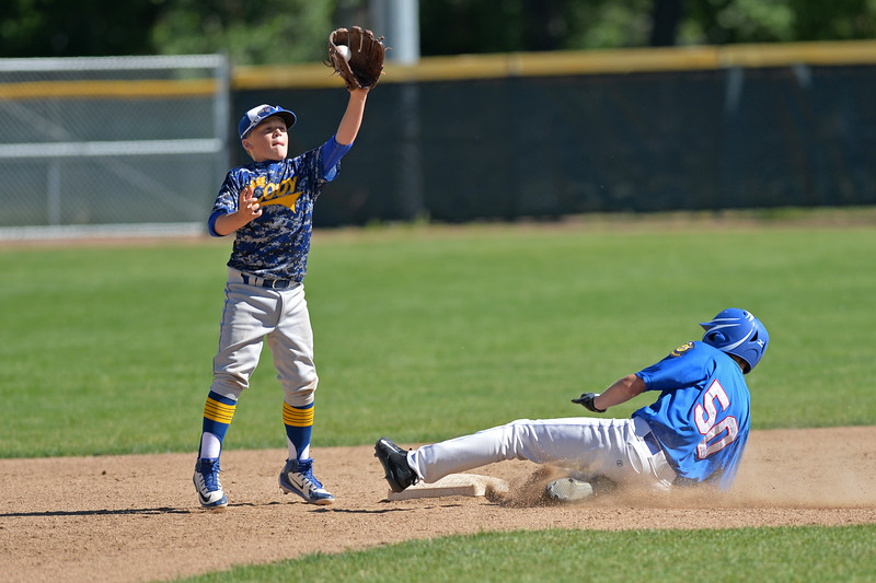 Mike Pruden | The Sheridan Press<br /> Cody's Logan McLeod, left, reaches to make a catch as Sheridan's Aston Wagoner slides safely into second base during the second game of a doubleheader at Thorne-Rider Stadium Tuesday, June 12, 2018.