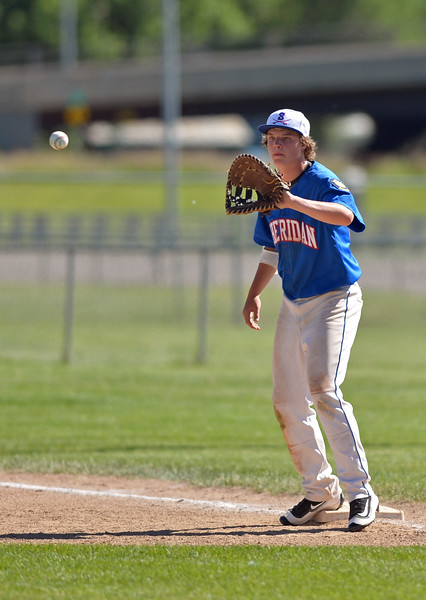 Mike Pruden | The Sheridan Press<br /> Sheridan's Caden Steel catches a throw at first base during the second game of a doubleheader against Cody at Thorne-Rider Stadium Tuesday, June 12, 2018.