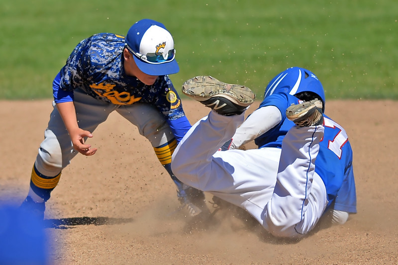 Mike Pruden | The Sheridan Press<br /> Cody's Logan McLeod, left, tags Sheridan's David Almaraz out at second base during the second game of a doubleheader at Thorne-Rider Stadium Tuesday, June 12, 2018.