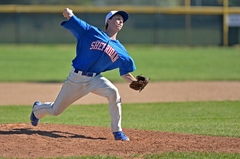 Mike Pruden | The Sheridan Press<br /> Sheridan's Luke Mullinax steps into a pitch during the second game of a doubleheader against the Cody Cubs at Thorne-Rider Stadium Tuesday, June 12, 2018.