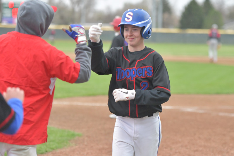 Ryan Patterson | The Sheridan Press<br /> Sheridan's Trevor Stowe receives congratulations from teammates during a game against the Gillette Rustlers at Thorne-Rider Stadium Sunday, May 5, 2019. The Jets won the game 17-8 and defeated Gillette earlier in the day 10-4.