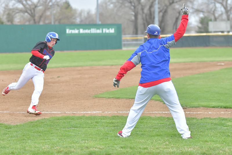 Ryan Patterson | The Sheridan Press<br /> Sheridan Jets head coach Austin Cowen, right, waves Caden Steel home during a game against the Gillette Rustlers at Thorne-Rider Stadium Sunday, May 5, 2019. The Jets won the game 17-8.