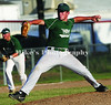 14 Zach Bradford rares back as 3rd baseman 9 Jared Turner concentrates on the batter