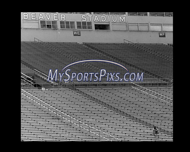 Penn State football coach Joe Paterno watches a practice alone in the stands at Beaver Stadium sometime in the late 80s in State College, Pa.