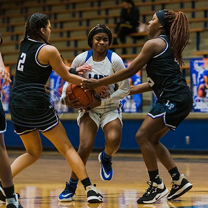 John Tyler's Shiriah Mitchell (2) fights for control of the ball against Lufkin defenders Mallory Patel (2) and Aaliyah Menefee (15) during game action Tuesday, Feb. 11, 2020, at John Tyler High School in Tyler. (Cara Campbell/Tyler Morning Telegraph)