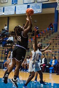 Lufkin's Aniya Cottrell (22) attempts a shot above John Tyler defender Errian Johnson (3) during game actionTuesday, Feb. 11, 2020, at John Tyler High School in Tyler. (Cara Campbell/Tyler Morning Telegraph)