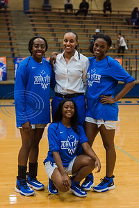 John Tyler players Makia Moon, (left) Errian Johnson and Symone Gray stand and sit for a photo with Head Coach Girls Basketball Amber Wiley during their senior night before game action against Lufkin Tuesday, Feb. 11, 2020, at John Tyler High School in Tyler. (Cara Campbell/Tyler Morning Telegraph)