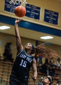 Lufkin's Aaliyah Menefee (15) goes up for a shot as John Tyler defenders look on during game actionTuesday, Feb. 11, 2020, at John Tyler High School in Tyler. (Cara Campbell/Tyler Morning Telegraph)