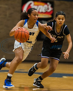 John Tyler's Kamora Jackson (1) dribbles the ball past Lufkin defender Alecia Rivera-Scott (4) during game action Tuesday, Feb. 11, 2020, at John Tyler High School in Tyler. (Cara Campbell/Tyler Morning Telegraph)