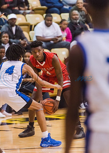 Tyler Lee's Jaiden Pinson (4) looks to pass the ball as John Tyler's Darrell Warren (4) attempts to guard him during in-town showdown game action Tuesday, Dec. 3, 2019, at Wagstaff Gym in Tyler. (Cara Campbell/Tyler Morning Telegraph)