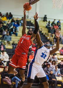 Tyler Lee's Jamal Jones (1) attempts a shot as John Tyler's Sean O'Neal (32) goes up to block during in-town showdown game action Tuesday, Dec. 3, 2019, at Wagstaff Gym in Tyler. (Cara Campbell/Tyler Morning Telegraph)
