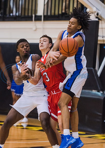 Tyler Lee and John Tyler players fight for the ball during in-town showdown game action Tuesday, Dec. 3, 2019, at Wagstaff Gym in Tyler. (Cara Campbell/Tyler Morning Telegraph)