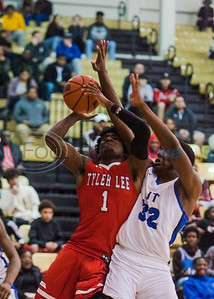 John Tyler's Sean O'Neal (32) attempts to block Tyler Lee's Jamal Jones' shot during in-town showdown game action Tuesday, Dec. 3, 2019, at Wagstaff Gym in Tyler. (Cara Campbell/Tyler Morning Telegraph)