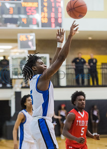 John Tyler's Jerome Jones (5) goes up for a shot during in-town showdown game action against Tyler Lee Tuesday, Dec. 3, 2019, at Wagstaff Gym in Tyler. (Cara Campbell/Tyler Morning Telegraph)