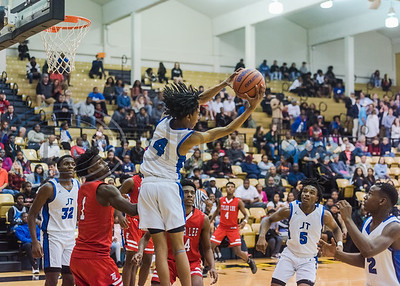 John Tyler's Darrell Warren (4) rebounds the ball mid-air during in-town showdown game action Tuesday, Dec. 3, 2019, at Wagstaff Gym in Tyler. (Cara Campbell/Tyler Morning Telegraph)