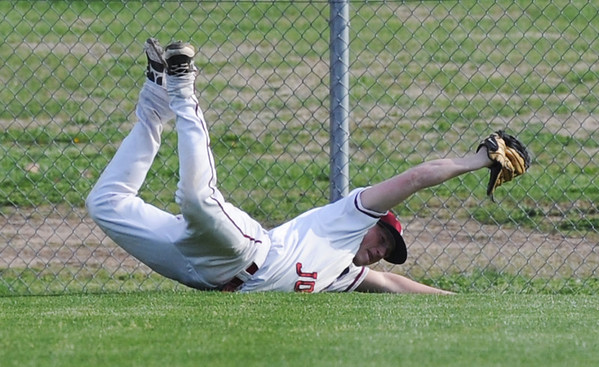 Globe/Roger Nomer<br /> Joplin's Ret Whisheu holds onto the ball after making a diving catch to end the inning with the bases loaded during Monday's game against Carl Junction.
