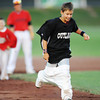 Globe/T. Rob Brown<br /> L.T. Atherton of Joplin, runs ahead of Isaac Erving, 8, of Webb City during a Joplin Outlaws baseball inning stretch Tuesday night, June 26, 2013. Erving ended up winning the race.