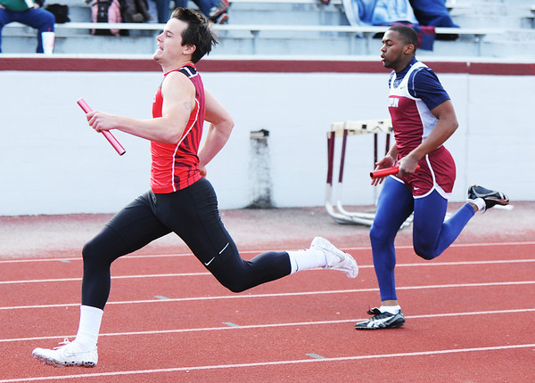 Globe/T. Rob Brown<br /> Carl Junction High School senior Nick Thompson heads toward the finish ahead of Joplin's Terrell Gilmore during the 4-by-1 relay Friday afternoon, April 19, 2013.
