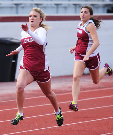 Globe/T. Rob Brown<br /> Joplin High School freshman Marley Robeson leads the pack in the 100 meter Friday afternoon, April 19, 2013.