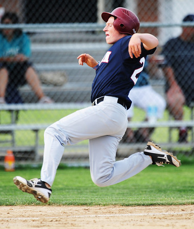 Globe/T. Rob Brown<br /> Joplin American Legion's Rex Whisner starts his slide toward the plate to score Joplin's first run against Carl Junction Tuesday evening, May 28, 2013, at Carl Junction High School's field. Williamson was called out on the play.