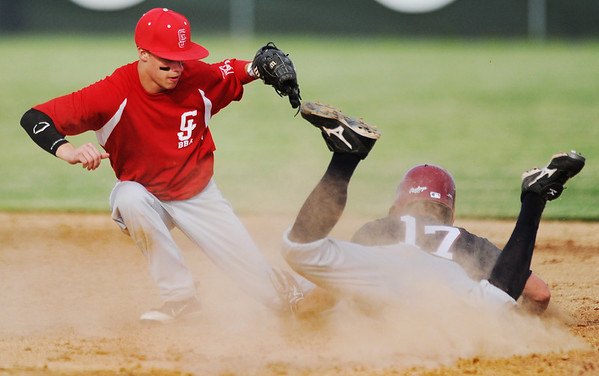 Globe/T. Rob Brown<br /> Carl Junction American Legion's Josh Petty watches Joplin's Gavin Williamson slide into second Tuesday evening, May 28, 2013, at Carl Junction High School's field. Williamson was called out on the play.