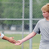 Globe/T. Rob Brown<br /> Joplin's Duncan Ford, left, claps hands with teammate Sam Wilcoxon after they scored a point during a doubles match against Carthage's Jonas Smith and Jacob Kunard Friday afternoon, May 10, 2013, at the Joplin Athletic Complex.