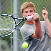 Globe/T. Rob Brown<br /> Joplin's Sam Willcoxon returns the ball during a doubles match with teammate Duncan Ford against Carthage's Jonas Smith and Jacob Kunard Friday afternoon, May 10, 2013, at the Joplin Athletic Complex.