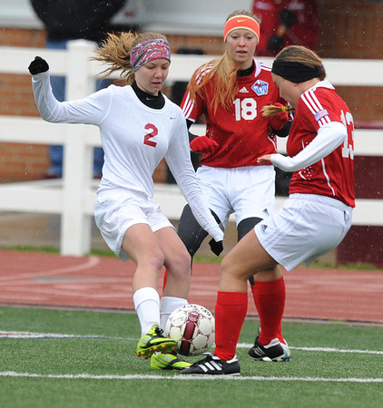 Globe/Roger Nomer<br /> Joplin's Kate Beckham fights for control of a ball with Glendale's Anna Powell (18) and Jessie Rogers (13) during Tuesday's game.