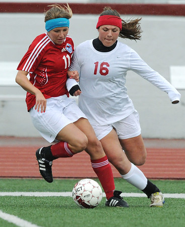 Globe/Roger Nomer<br /> Joplin's Anna Banwart takes a ball away from Glendale's Kasey Shea Opfer during Tuesday's game.