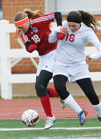 Globe/Roger Nomer<br /> Glendale's Annie Powell and Joplin's Maggie Miller fight for a ball during Tuesday's game.