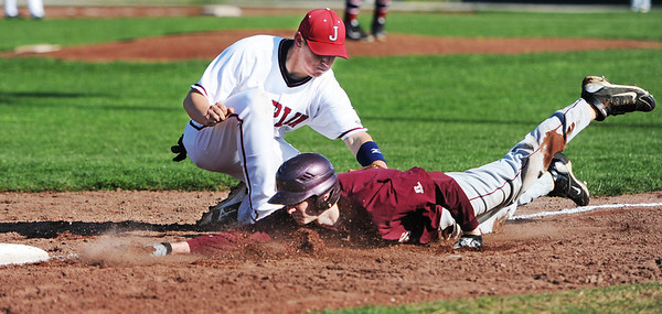 Globe/T. Rob Brown<br /> Joplin High School third baseman Brett Graham tags out Rolla runner Matthew Claypool before he can return to third during Wednesday evening's game, April 24, 2013, at Joe Becker Stadium in Joplin.