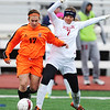 Globe/T. Rob Brown<br /> Joplin High School senior Niki Barlos attempts to steal the ball from Waynesville Tuesday evening, April 23, 2013, at Junge Field.