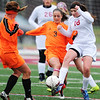 Globe/T. Rob Brown<br /> Joplin High School junior Maggie Miller kicks the ball as Waynesville attempts to steal Tuesday evening, April 23, 2013, at Junge Field.