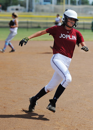 Joplin runner (4) heads to second base just before scoring a run against Webb City during Saturday afternoon's game, Sept. 14, 2013, at the Joplin Athletic Complex softball field.<br /> Globe | T. Rob Brown
