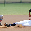 Joplin's (4) slides safely into second base as Webb City's (77) tries to catch a bounced throw during Saturday afternoon's game, Sept. 14, 2013, at the Joplin Athletic Complex softball field.<br /> Globe | T. Rob Brown