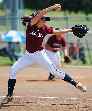 Joplin pitcher (9) hurls the ball toward the plate to a Webb City batter during Saturday afternoon's game, Sept. 14, 2013, at the Joplin Athletic Complex softball field.<br /> Globe | T. Rob Brown