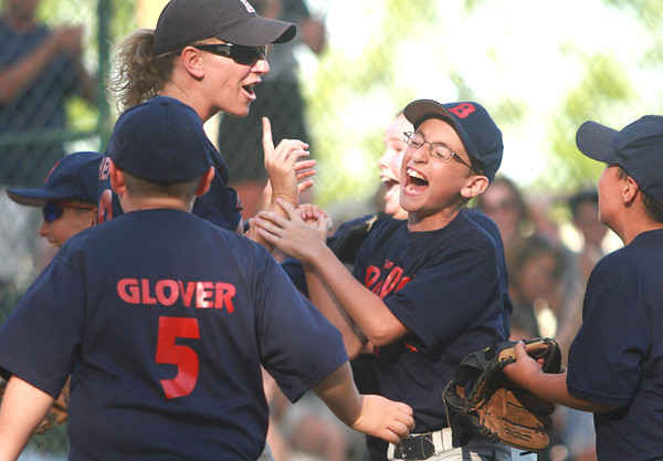 6-13-12<br /> Bullpen of Russiaville celebrates after their 8-4 win against Fast Lane Foods of Russiaville during the youth baseball tournament game on Wednesday.<br /> KT photo | Kelly Lafferty