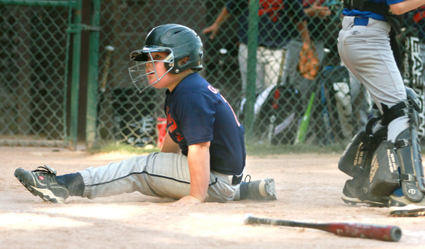 6-13-12<br /> Tim Galloway of Bullpen slides into home for a run. Bullpen of Russiaville beat Fast Lane Foods of Russiaville in the youth baseball tournament game 8-4 on Wednesday.<br /> KT photo | Kelly Lafferty
