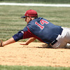 6-9-12     ---  Western  WON 11-7<br /> Western HS vs Bellmont Semi-State Baseball at Highland Park<br /> Bellmont's Landon Baker diving for the ball that was hit by Dakota Lamott. Lamott scored later in the inning.<br /> KT photo | Tim Bath