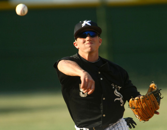 6-5-12<br /> Post 6 Baseball at Highland Park CFD Stadium.<br /> Cody Shipley throwing to first.<br /> KT photo | Tim Bath