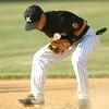 6-5-12<br /> Post 6 Baseball at Highland Park CFD Stadium.<br /> 2nd baseman Cody Shipley fumbling with the ball.<br /> KT photo | Tim Bath