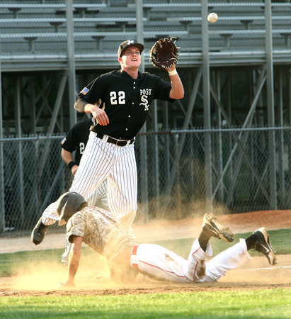 6-5-12<br /> Post 6 Baseball at Highland Park CFD Stadium.<br /> Drew Hansen pulling in a catch at 3rd but to late for the tag of Post 19 Brooks Mace.<br /> KT photo | Tim Bath