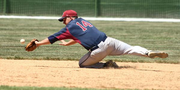 6-9-12     ---  Western  WON 11-7<br /> Western HS vs Bellmont Semi-State Baseball at Highland Park<br /> Bellmont's Landon Baker diving for the ball that was hit by Dakota Lamott. Lamott scored later in the inning.<br /> KT photo | Tim Bath