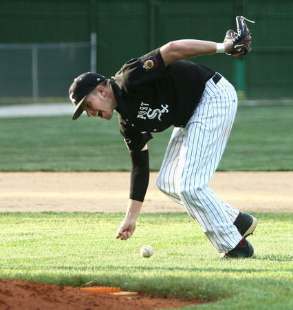 6-5-12<br /> Post 6 Baseball at Highland Park CFD Stadium.<br /> Drew Hansen fumbling with a ball that the pitcher missed.<br /> KT photo   Tim Bath