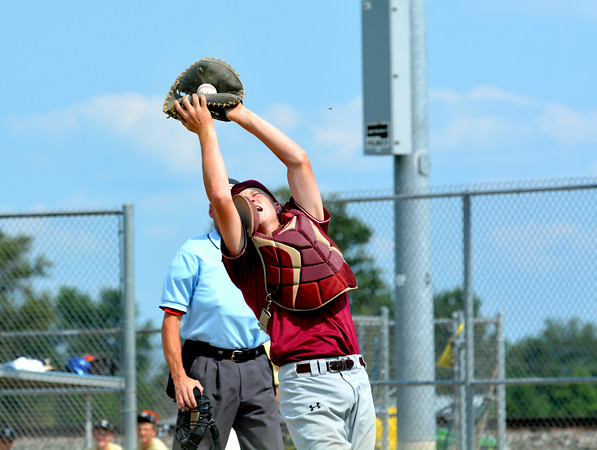 Dieterich Post 628 catcher Clayton Campton reaches back and snares a foul ball for an out against Teutopolis Post 924.